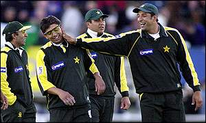 Saqlain Mushtaq is congratulted by his team-mates