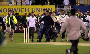 Pakistan supporters stage a pitch invasion