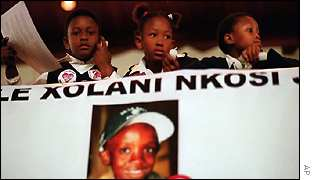 Children attend a memorial service in downtown Johannesburg Wednesday, June 6, 2001,
