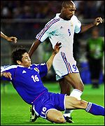 Japan's Koji Nakata tackles France's Nicolas Anelka