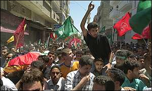 Palestinians carry the coffin of one of the three women killed by Israeli tank fire on Saturday