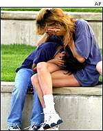 A mother cries with her daughter as they visit the Oklahoma City National Memorial in Oklahoma City
