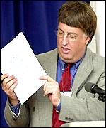 Daily Oklahoman reporter Nolan Clay holds up a copy of the final statement of Timothy McVeigh