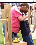 Relatives hug at Oklahoma City memorial