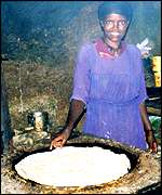 Woman cooking njera