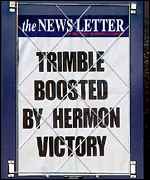 A newspaper billboard reports Sylvia Hermon's electoral victory