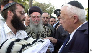 Israeli PM Ariel Sharon attends the funeral of Yehuda Haim Shoham