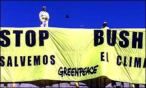 Greenpeace banner reading Stop Bush - save the climate