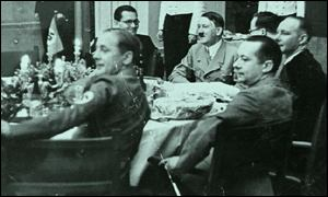 Adolf Hitler at a Nazi dinner