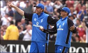 Dominic Cork congratulates Darren Gough for catching Hayden off Caddick's delivery