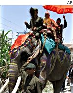 Brahmin priest rides an elephant out of Kathmandu in a traditional Hindu ceremony