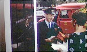 Postman delivers letters to woman