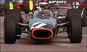 Jackie Stewart drives a BRM at Goodwood