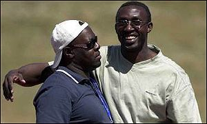 Mike McFarlane with Linford Christie in Australia