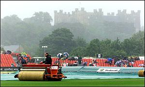 Groundstaff do their best to cope with the rain at Chester-le-Street