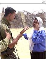 Israeli solider arguing with a Palestinian woman near Dahaniya