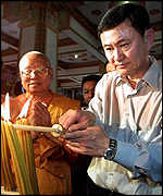 Prime Minister of Thailand Thaksin Shinawatra with Buddhist monks
