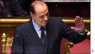 Silvio Berlusconi waves prior to delivering a speech before the Senate