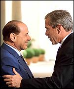 Italian Prime Minister Silvio Berlusconi greets US President George Bush at the start of the summit