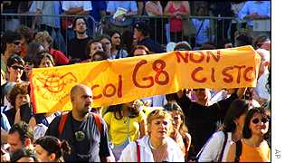 Protesters at women's rally hold anti G8 sign