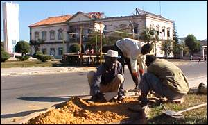 Workers carry out road repairs