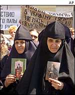 Ukrainian Orthodox nuns march through downtown Kiev during a protest against the Pope