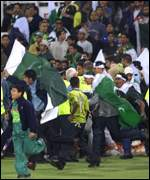 Fans charge onto the field at Trent Bridge