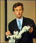 [ image: BBC Health Correspondent Fergus Walsh with a colposcope used to look at the cervix]