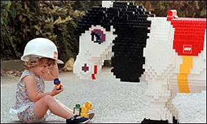 Child playing with Lego Duplo horse