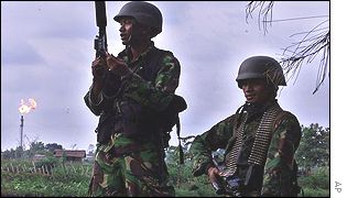 Indonesian soldiers patrol the Arun gas fields near in Aceh in April