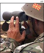 A Macedonian army officer observes rebel positions