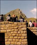 Tourists at the ancient Inca citadel of Machu Picchu
