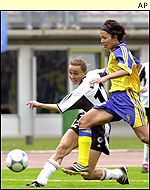 Germany's Claudia Mueller fights for the ball against Sweden's Jana Toernqvist