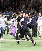 Fans invade the Lords pitch