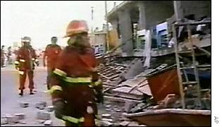 Firefighters inspect damaged building in Tacna