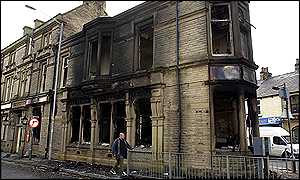 The Duke of York public house stands burned out