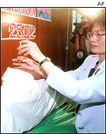 A vaccine shot is administered at a medical centre in Bangkok