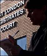 A reporter outside West London Magistrates Court