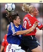 France's Aline Riera battles for the ball with Norway's Ragnhild Gulbrandsen