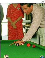 Prince Charles playing pool AP