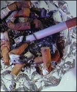 A cigarette and ashtray