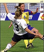 Sweden's Malin Mostroem fights for the ball with England's Rachel Unitt