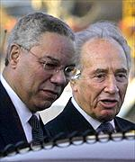 Israeli Foreign Minister Shimon Peres, right, receives US Secretary of State Colin Powell upon his arrival in Israel
