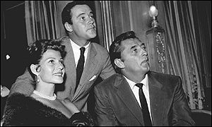Lemmon pictured in 1956 with fellow stars Rita Hayworth and Robert Mitchum