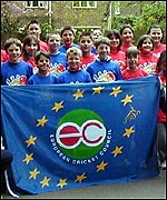 French children holding the European Cricket Council flag