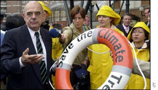 Jan Pronk, lifebuoy and oilskinned protestors AP