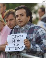 A sign reading 'Send Him To Texas', referring to the US state where the death penalty is legal
