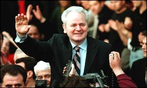 Slobodan Milosevic greeting supporters outside his villa on 24 March 2001