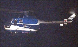 Dutch police helicopter transporting Mr Milosevic