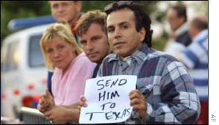Protesters at The Hague holding a piece of paper reading: 'Send him to Texas' - the US state with the highest execution rate
